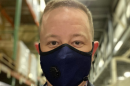 Adam Justice wearing a mask